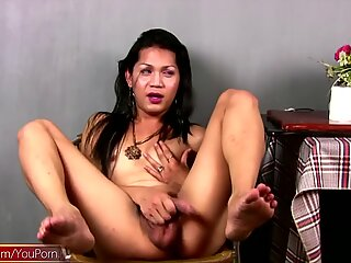 Thai TS takes off panties and shows big cock with huge balls