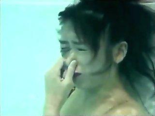 Breath holding girl underwater